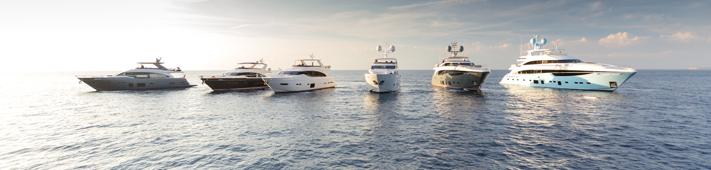 Six Princess yachts in the ocean.