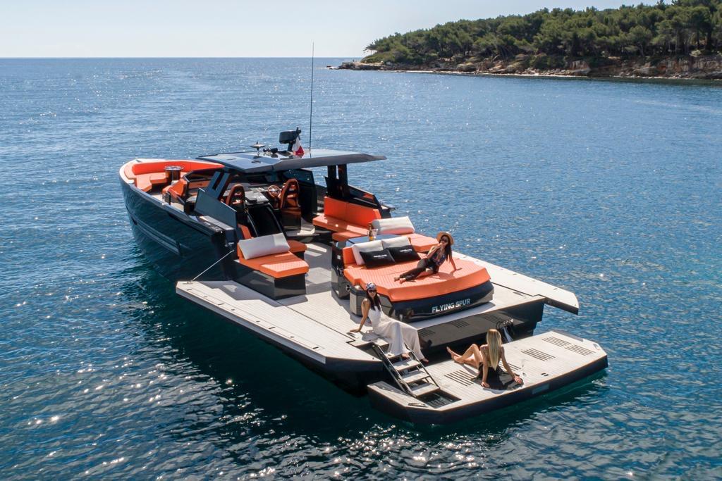OKEAN 55 sport day boat with people sunbathing