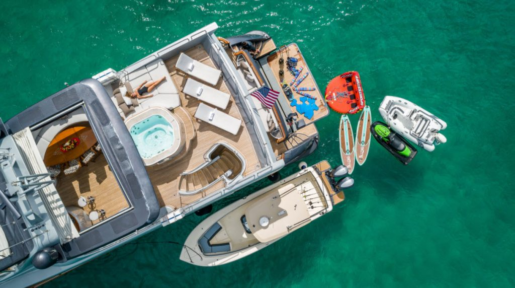 Yacht with tender and water toys